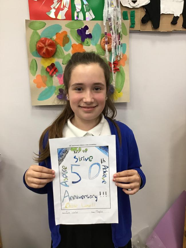 Evie Waite with her winning poster to promote the school's 50th anniversary year