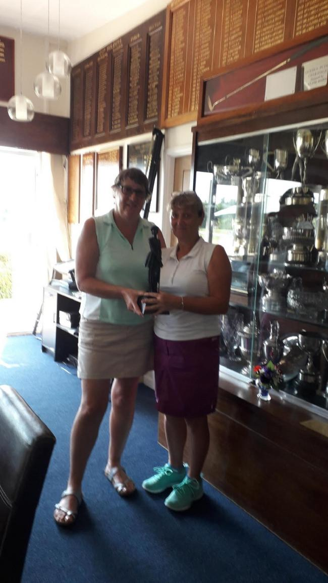 Impressive score: Lady captain Kate Fender presents the ladies' championship trophy to Sue Keen.