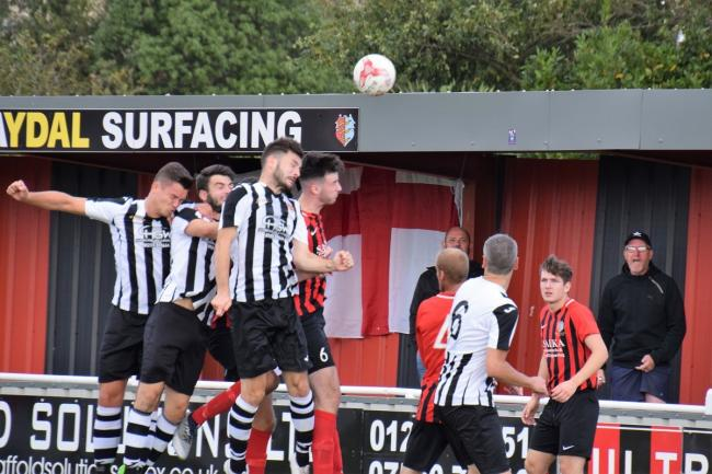 Aerial duel: Sam Cripps, Jordan Heath and Dan Clarke challenge for the ball in Saturday's victory at Brightlingsea Picture: Chris Smith
