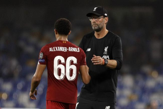 Liverpool manager Jurgen Klopp shakes hands with Trent Alexander-Arnold