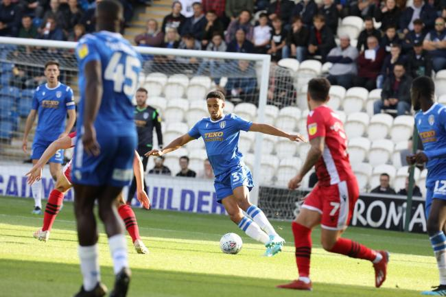 On the ball - Cohen Bramall in possession during Colchester United's defeat against Morecambe Picture: STEVE BRADING