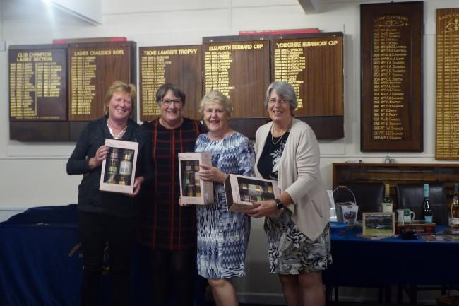 Prize time: Ladies' captain Kate Fender presented the prizes to the winning team of Kris Matthews, Chris Bradford and Anne Myers.