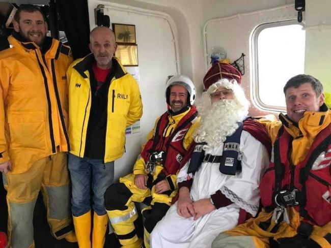 SPECIAL GUEST: St Nicholas with RNLI crew members. From left to right: John Alcock, Andrew Moors, Adrian Jenner, St Nickolas, and Phil Gilbert