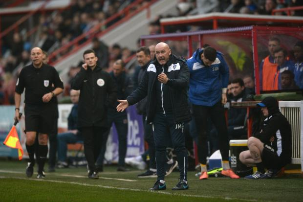 In charge - Colchester United head coach John McGreal points instructions to his team from the touchline Picture: RICHARD BLAXALL
