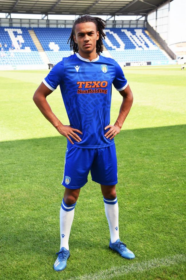 Getting shirty - U's defender Miles Welch-Hayes models the new Colchester United shirt WWW.CU.FC.COM