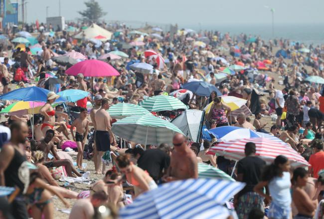 Packed - Enjoying the weather at Southend beach Image: PA