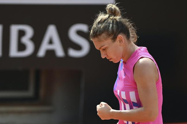 Simona Halep reacts to winning a point against Yulia Putintseva