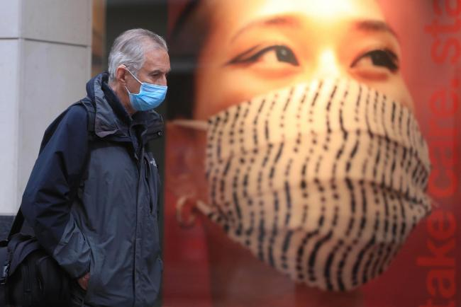 A man wearing a face mask. Picture: Mike Egerton/PA Wire