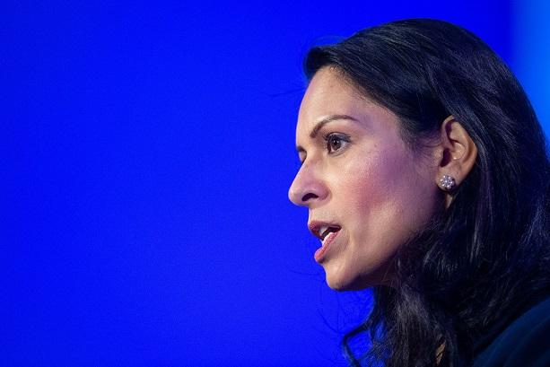 Advisor on ministers code quits as PM backs Priti Patel