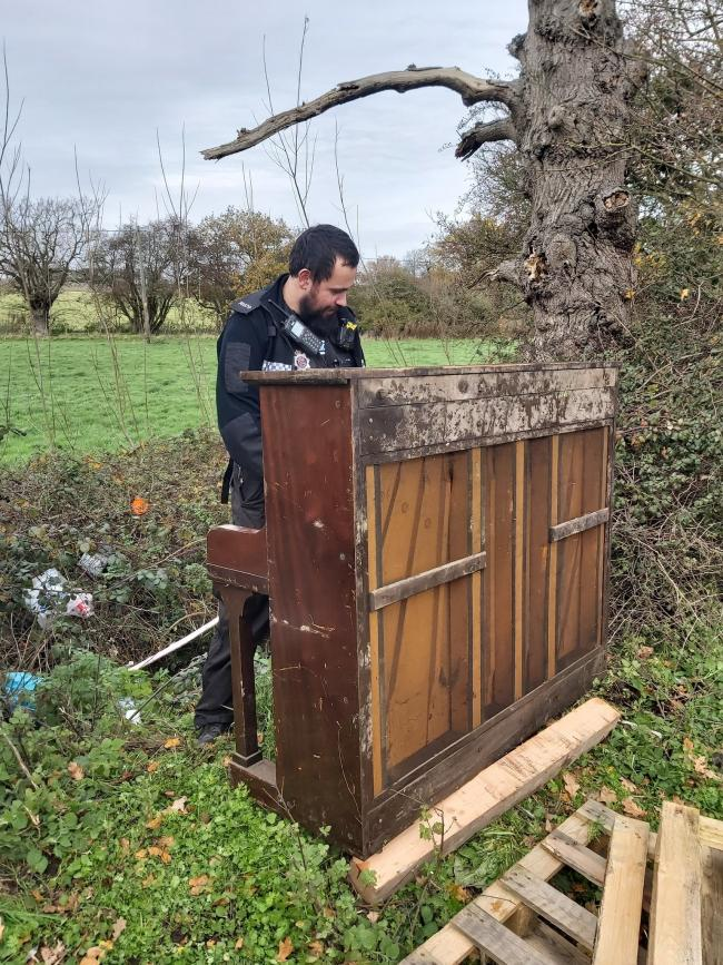 On duty - PC Jed Raven in shock as finding a fly-tipped piano in Ramsey Picture: Andy Long