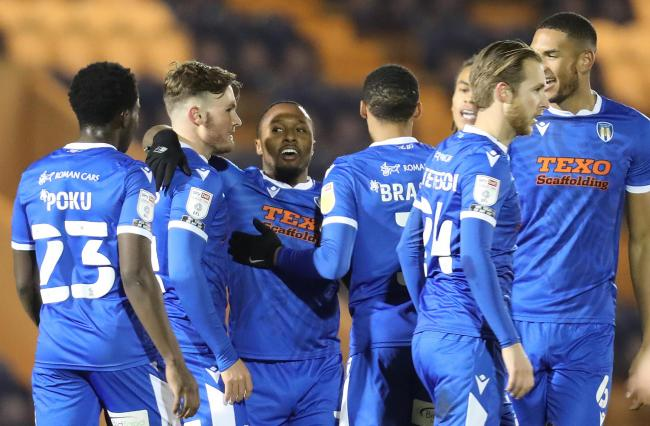 Magnificent - Colchester United's Callum Harriott (third from left) celebrates with his team-mates after scoring a superb goal against Crawley Town Picture: STEVE BRADING