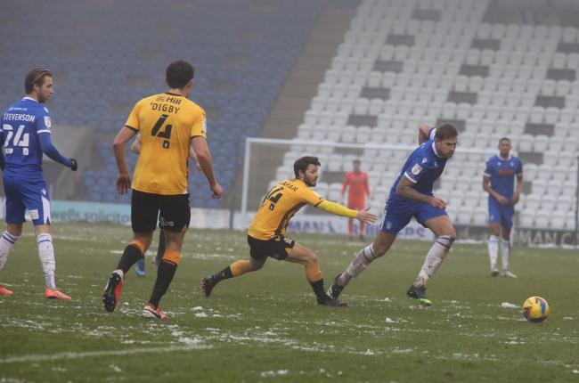 Making strides - Colchester United skipper Harry Pell in action against Cambridge United Picture: STEVE BRADING