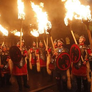 Harwich and Manningtree Standard: Thousands of people take part in a torchlight procession through Edinburgh