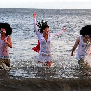 Swimmers take part in the New Year's Day Dip at Whitley Bay in North Tyneside