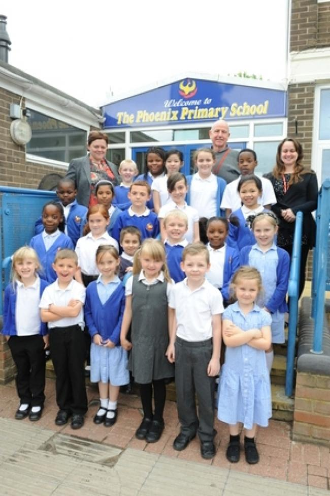 Headteacher Tracy Ahern, site manager Derick Richards and deputy head Lisa German with pupils