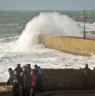 Rough seas in the harbour at Porthleven, Cornwall, as England and Wales face a battering from the worst storm in five years, forecasters warn.