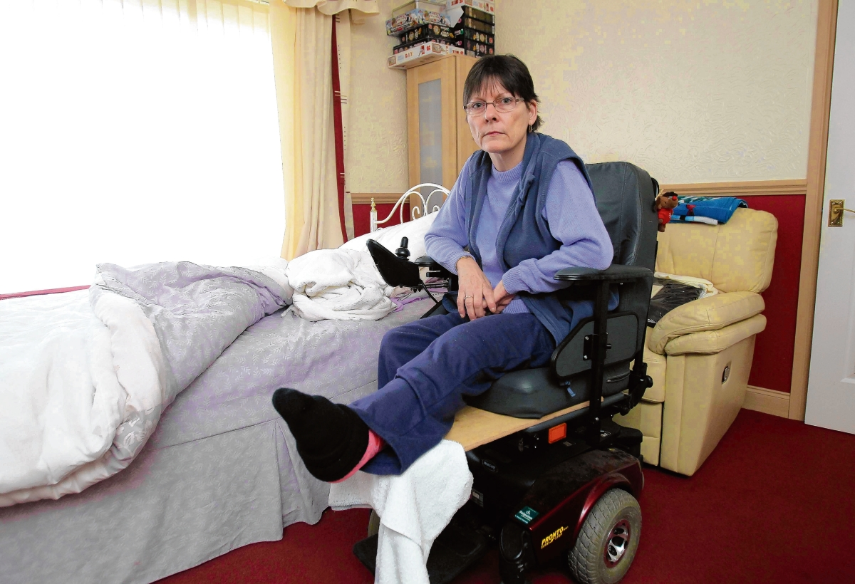Disabled woman 'left alone' with broken leg
