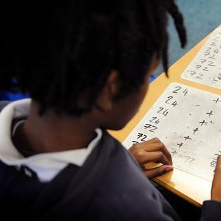 A primary school pupil at work in a classroom