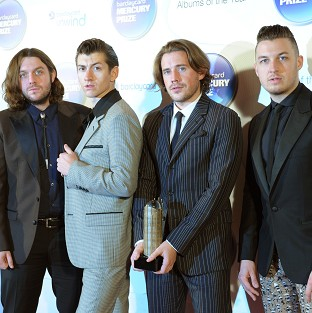 The Arctic Monkeys are to headline two festivals this summer