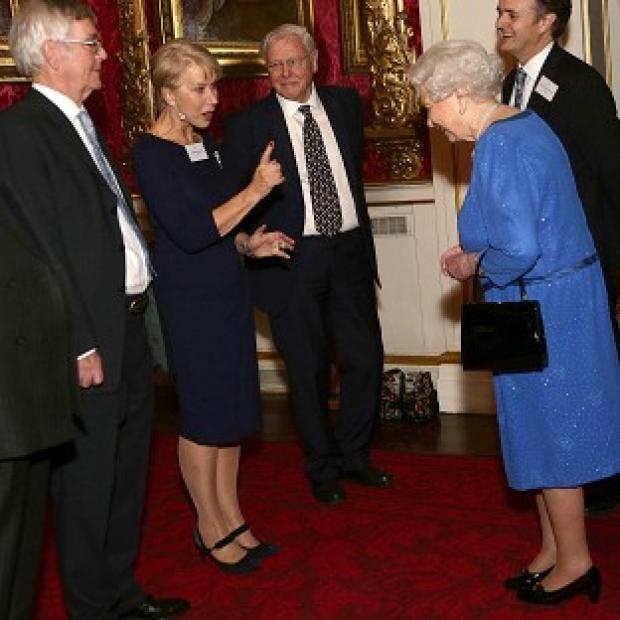Harwich and Manningtree Standard: Queen Elizabeth II (right) meeting Dame Helen Mirren, as Sir David Attenborough (third left) looks on, during a Reception for the Dramatic Arts, at Buckingham Palace, London.