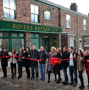 Coronation Street cast members on the new set, including the famous cobbles