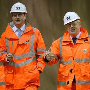 David Cameron (left) and Boris Johnson visiting a construction site. The PM wants the London Mayor to return to Parliament