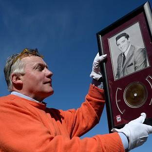 Harwich and Manningtree Standard: Jim Railton holds a rare strand of Elvis Presley's hair which is to be auctioned