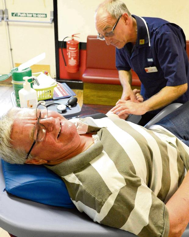 Harwich and Manningtree Standard: Donor David gives his hundredth pint of blood
