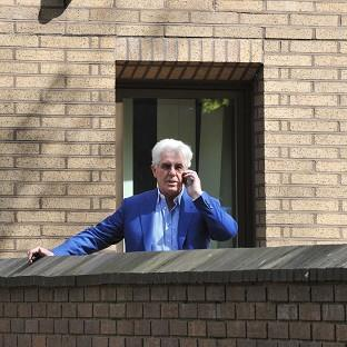 Harwich and Manningtree Standard: Publicist Max Clifford makes a phone call during a break in his trial at Southwark Crown Court