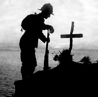 Harwich and Manningtree Standard: A soldier pays his respects at the grave of a colleague near Cape Helles, where the Gallipoli landings took place