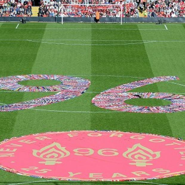 Harwich and Manningtree Standard: Fans' scarves make up a 96, filling the centre circle before the Hillsborough 25th Anniversary Memorial Service at Anfield Stadium, Liverpool