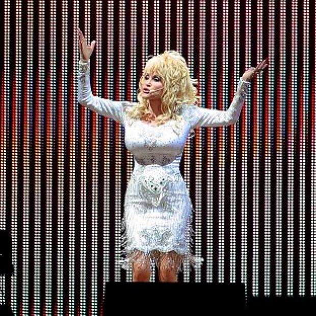 Harwich and Manningtree Standard: Dolly Parton is planning to wear high heels when she makes her Glastonbury debut