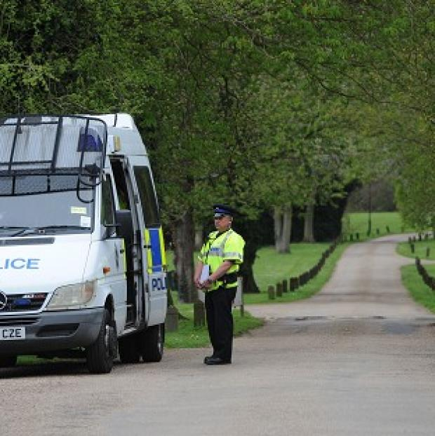 Harwich and Manningtree Standard: Police at the gate to Down Hall Country House Hotel in Hatfield Heath, Essex, where a couple were found dead in a swimming pool