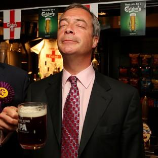Ukip leader Nigel Farage enjoys a pint in the Hoy and Helmet pub in South Benfleet, Essex, as his party makes election gains