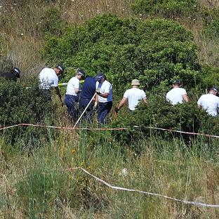 Harwich and Manningtree Standard: Police investigating the disappearance of Madeleine McCann in Portugal search a patch of scrubland