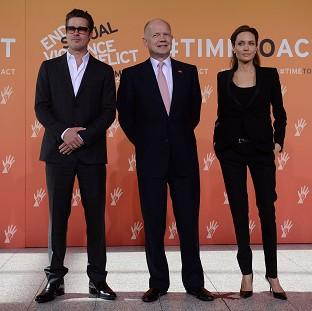 Harwich and Manningtree Standard: Foreign Secretary William Hague (centre), Brad Pitt and Angelina Jolie arrive at the End Sexual Violence in Conflict Summit at the Excel centre in east London.