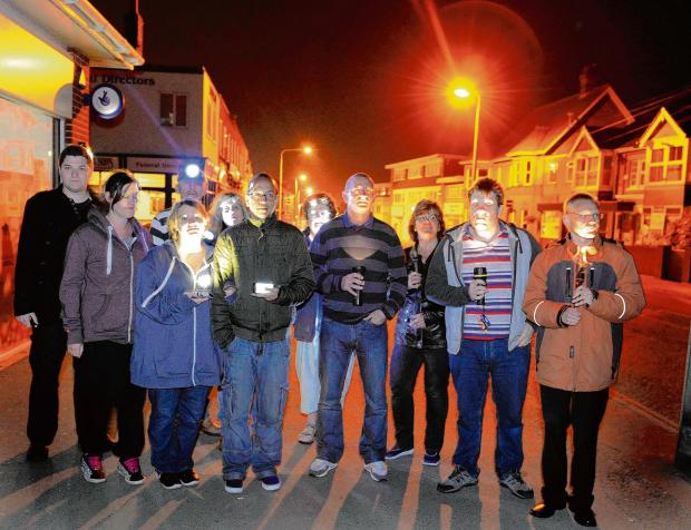 Torchlit vigil against overnight switch-off hailed as big success