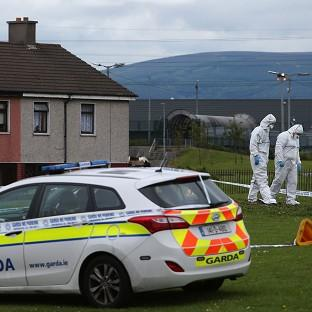 Harwich and Manningtree Standard: Members of the Garda forensic team at the crime scene in Croftwood Gardens, Dublin, where a six-year-old boy was shot