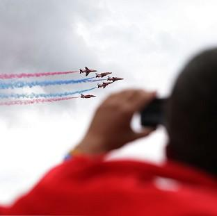 Harwich and Manningtree Standard: The Red Arrows display team flying above the Isle of Wight Festival