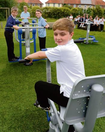 Children line up to use outdoor gym