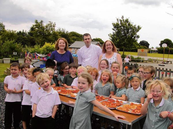 School children get a pizza the action