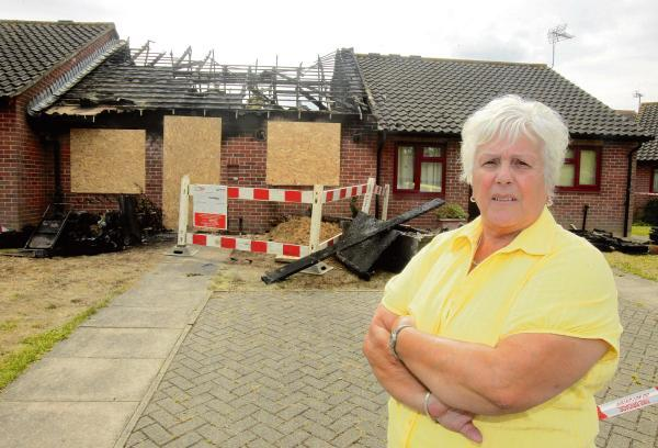 Neighbours show support for woman pulled from fire