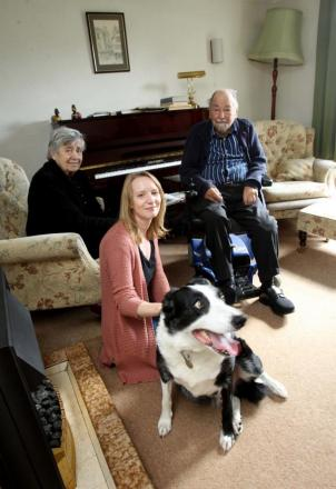 Janine Gilbank with Rita and Derek Norman and their dog Jasper