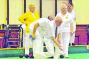EASY DOES IT: Chris Barker delivers his bowl against the Suffolk Vice-Presidents, with Carol Harrington (left) and Jean Reeder (right) looking on.