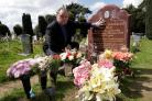 Distraught husband asks why flowers are removed from his wife's grave