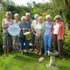 Harwich and Manningtree Standard: FLOWER POWER: Jen and Jill Frederickson with visitors to their garden last weekend.