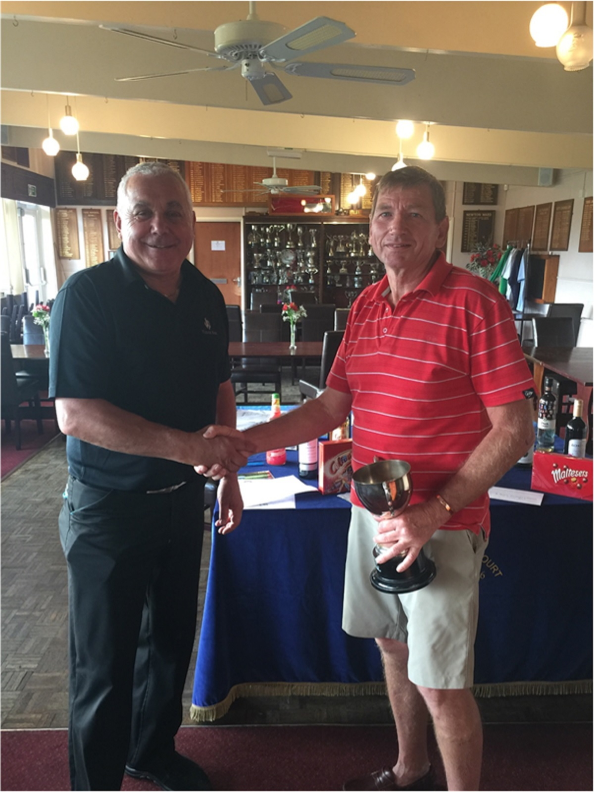 Worthy cause - Terry Woodward receives the Plonkers Cup from Lee Rodger. The event raised more than £800 for Cancer Research