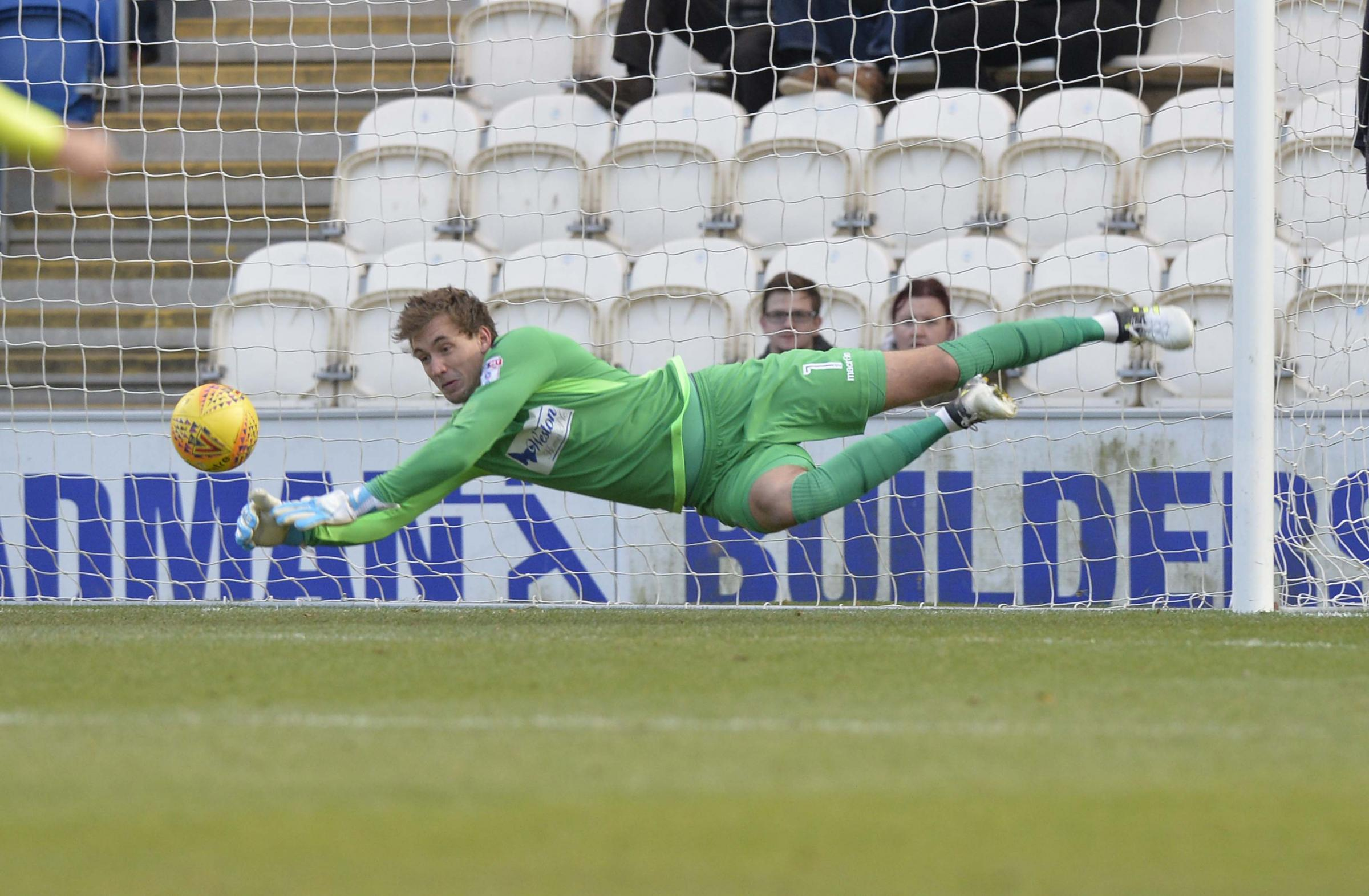 At full stretch - Colchester United goalkeeper Sam Walker keeps the ball out Picture: STEVE BRADING