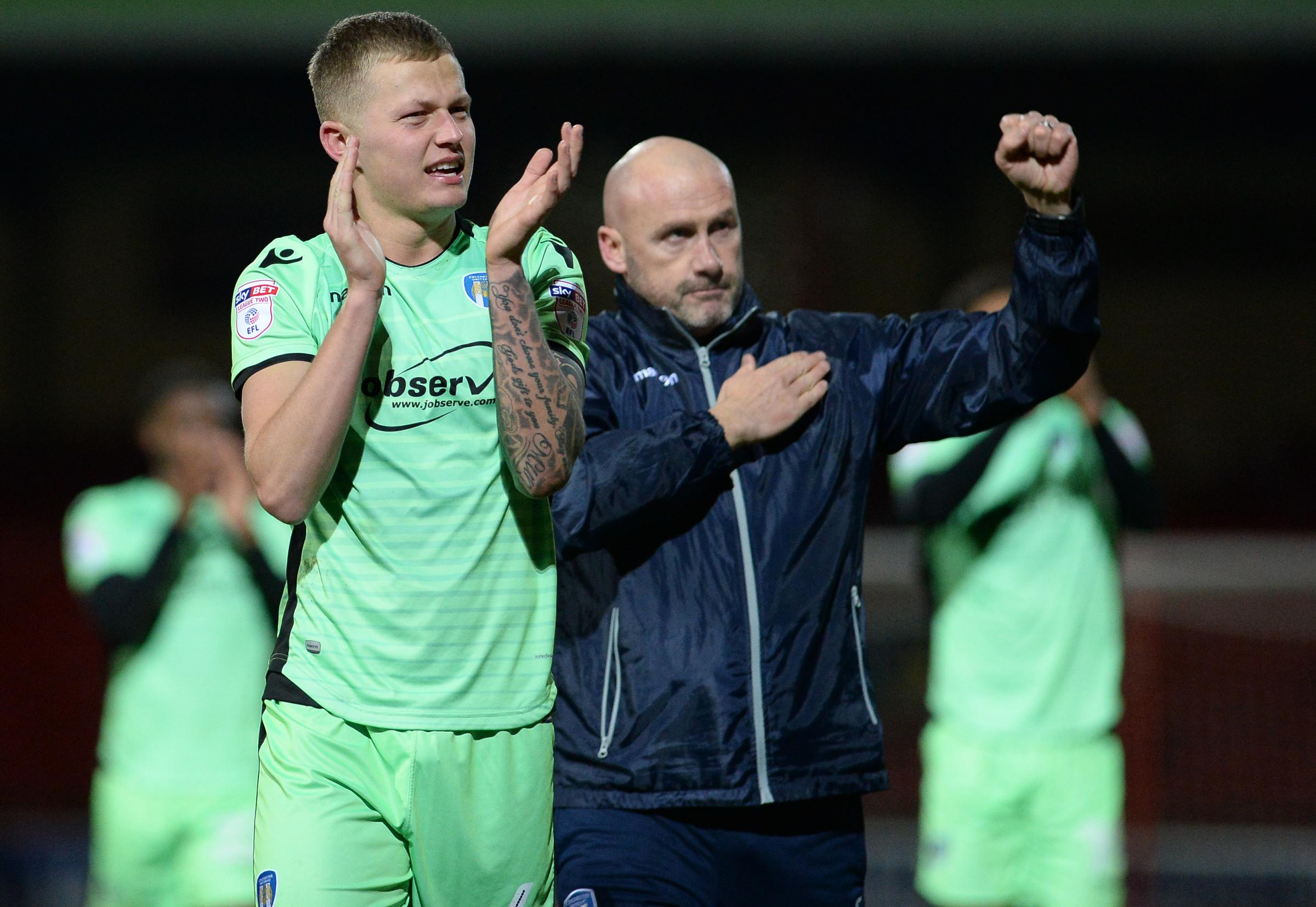 Heartfelt - Colchester United defender Frankie Kent and head coach John McGreal applaud the U's travelling fans after their 3-2 win at Swindon Town Picture: WARREN PAGE