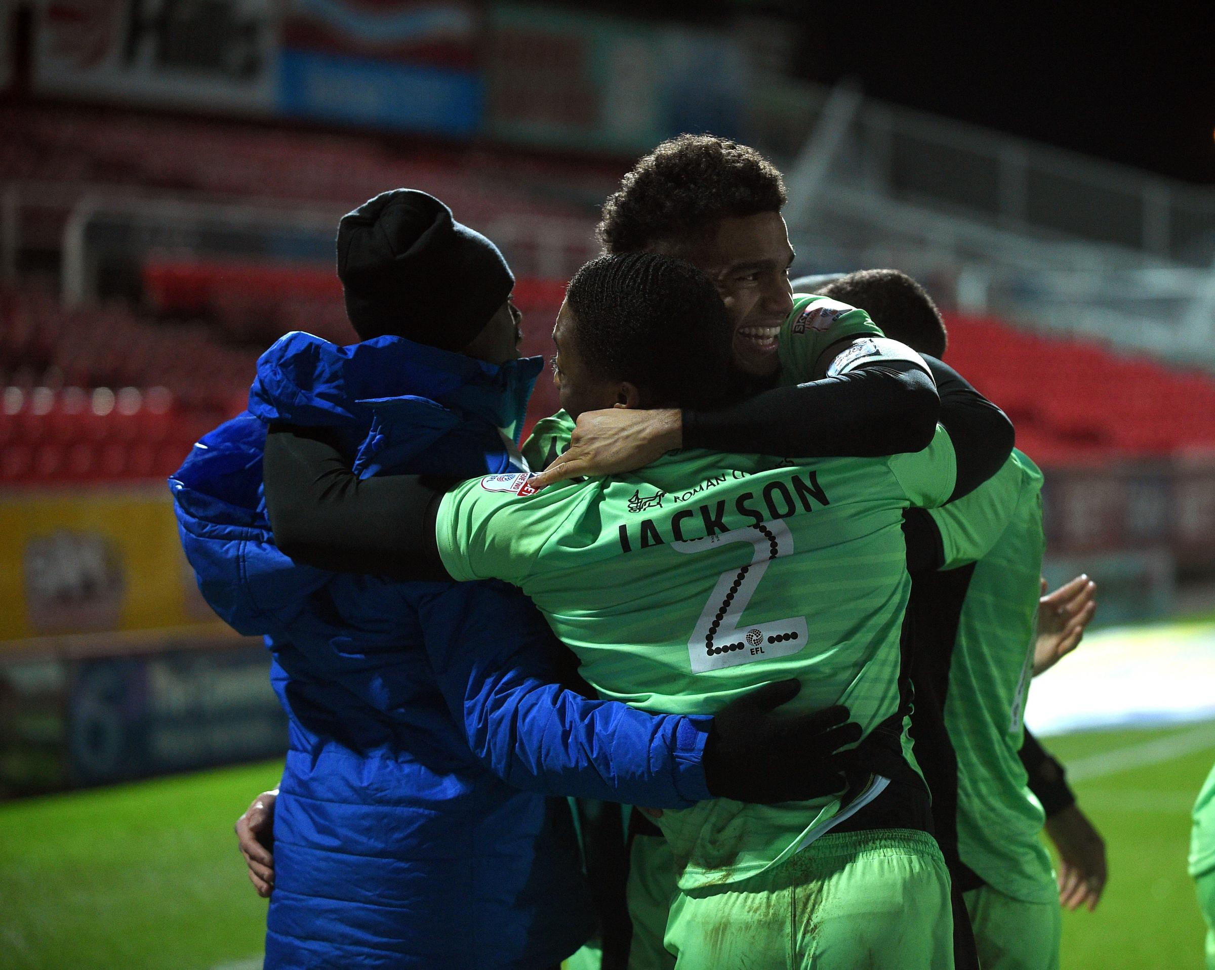 Feel-good factor - Colchester United's players celebrate after their win at Swindon Town Picture: WARREN PAGE